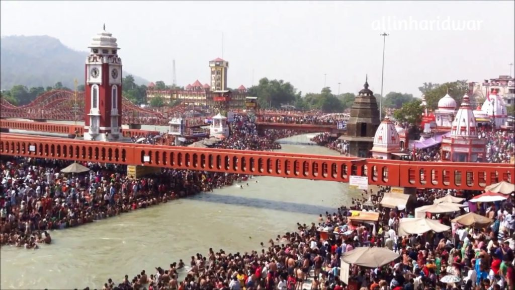 Priests and people take a Holy Bath on the Ganga Dussehra Day